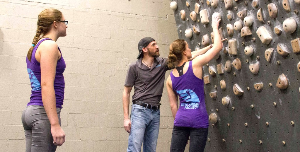 Coach Taylor Reed working with climbers