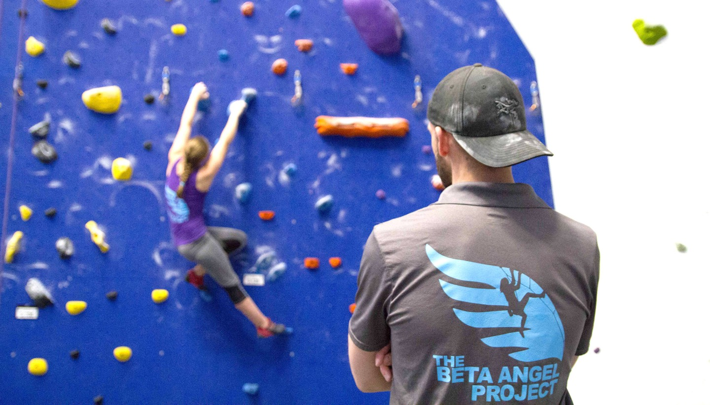 Coach Taylor Reed coaching a youth climber